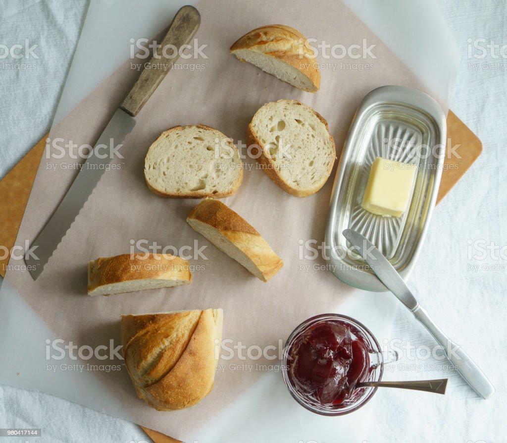 Rustic Bread, Butter, and Raspberry Jelly stock photo