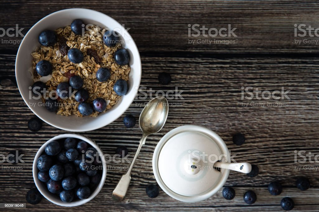 A rustic breakfast of granola and blueberries stock photo
