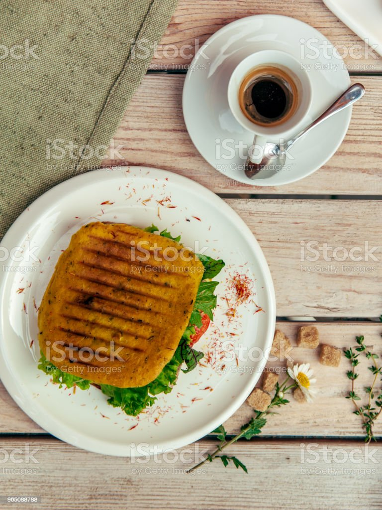 rustic breakfest with cappuccino and sandwich on wooden table with fork and knife zbiór zdjęć royalty-free