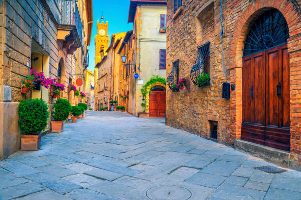 rustic brick and stone houses decorated with colorful flowers, italy - деревня стоковые фото и изображения