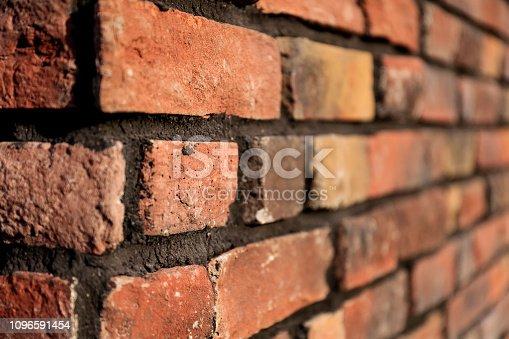 Fragment of brown brick wall