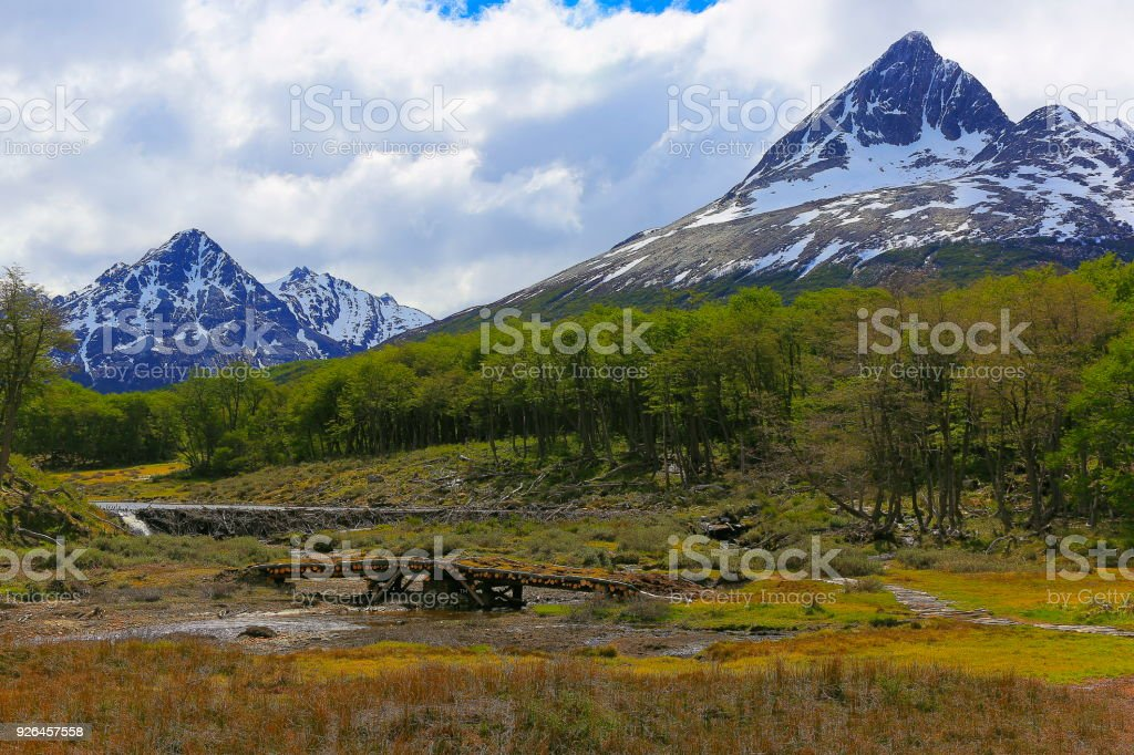 Rustic bridge and snowcapped landscape, Ushuaia - Tierra Del fuego, Argentina stock photo