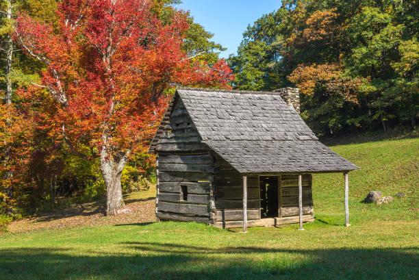 Rustic cabin and fall foliage stock photo
