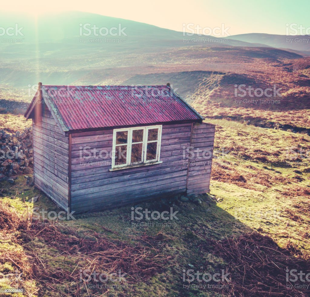 Rustic Cabin In The Wilderness stock photo
