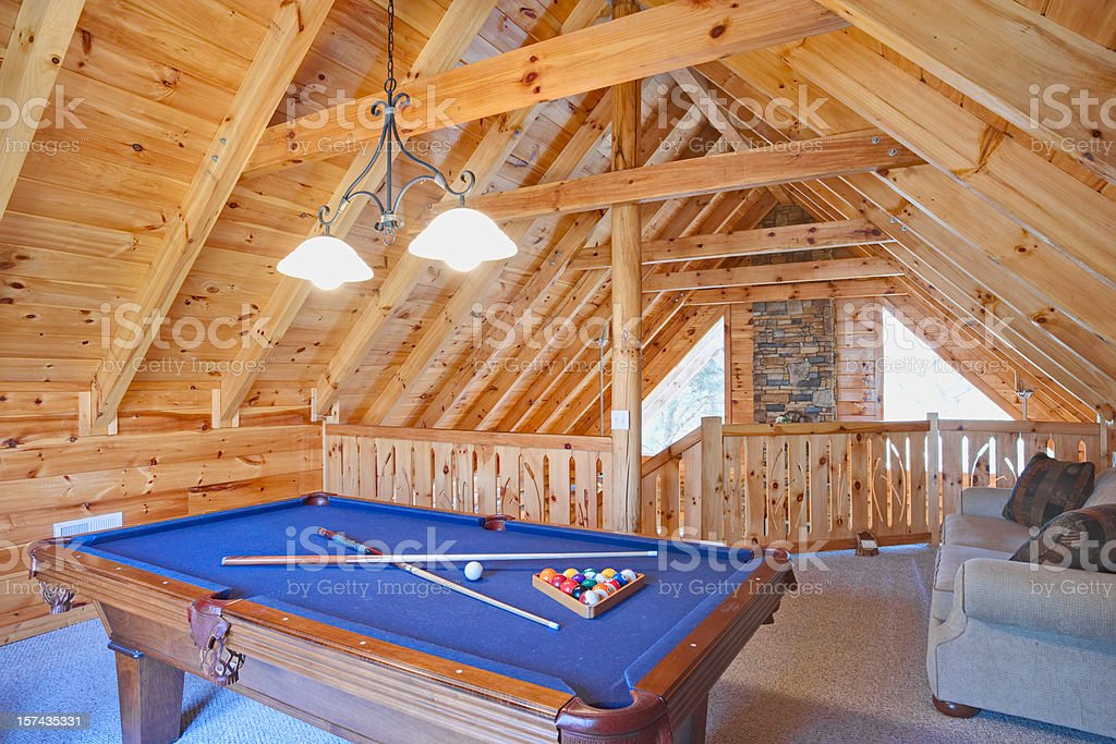 Rustic cabin loft with pool table (XXL) stock photo