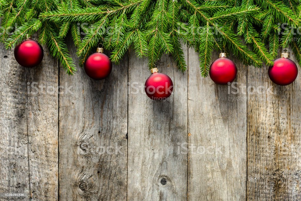 Rustic Christmas Card With Ornaments Red Baubles Hanging On Branches ...