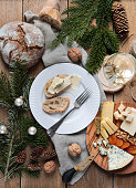 rustic Christmas Cheese Board flatlay with White Wine and bread on wood