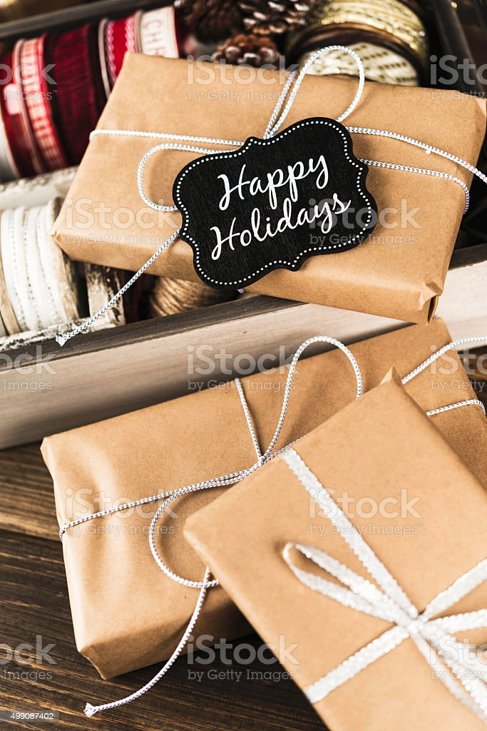 Rustic Christmas Gifts With Happy Holidays Gift Tag Stock Photo ...