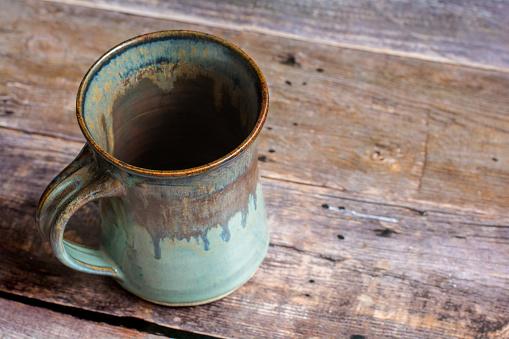 Rustic Clay Mug on a Old Barn Board Floor
