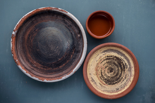 Rustic clay plates on the table
