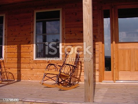 Amish made rocking chair on porch of cabin.