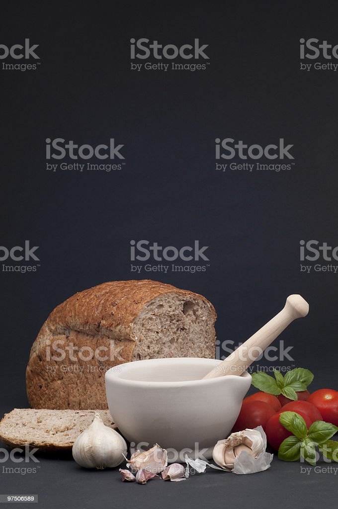 rustic cooking with bread, garlic and tomatoes royalty-free stock photo