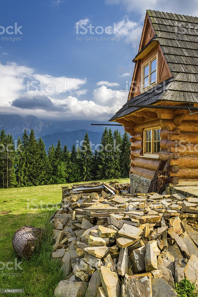 Rustic cottage in the mountains stock photo