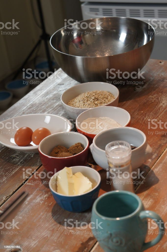 A rustic counter in a kitchen with bowls of baking ingredients stock photo
