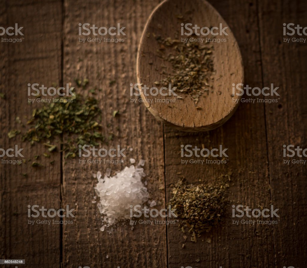 Rustic country style cooking on a wooden table with spices