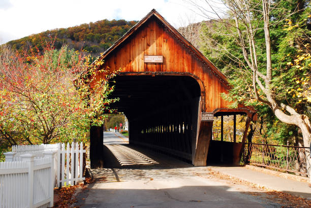 A rustic covered bridge in Vermont stock photo
