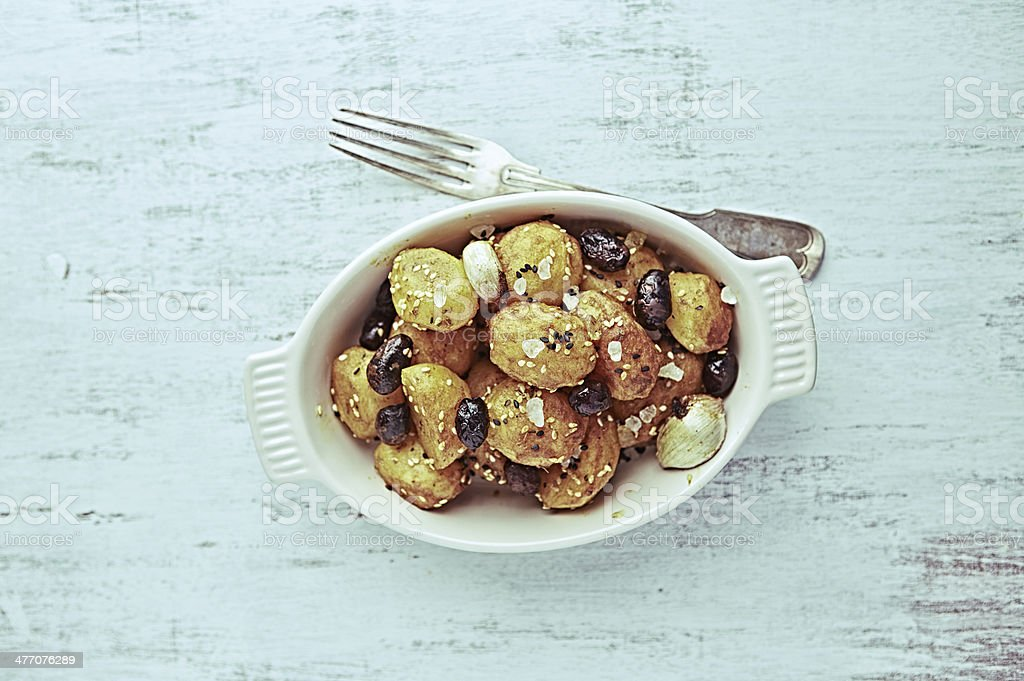 Rustic Cuisine. Oven-Baked Potatoes with Olives royalty-free stock photo