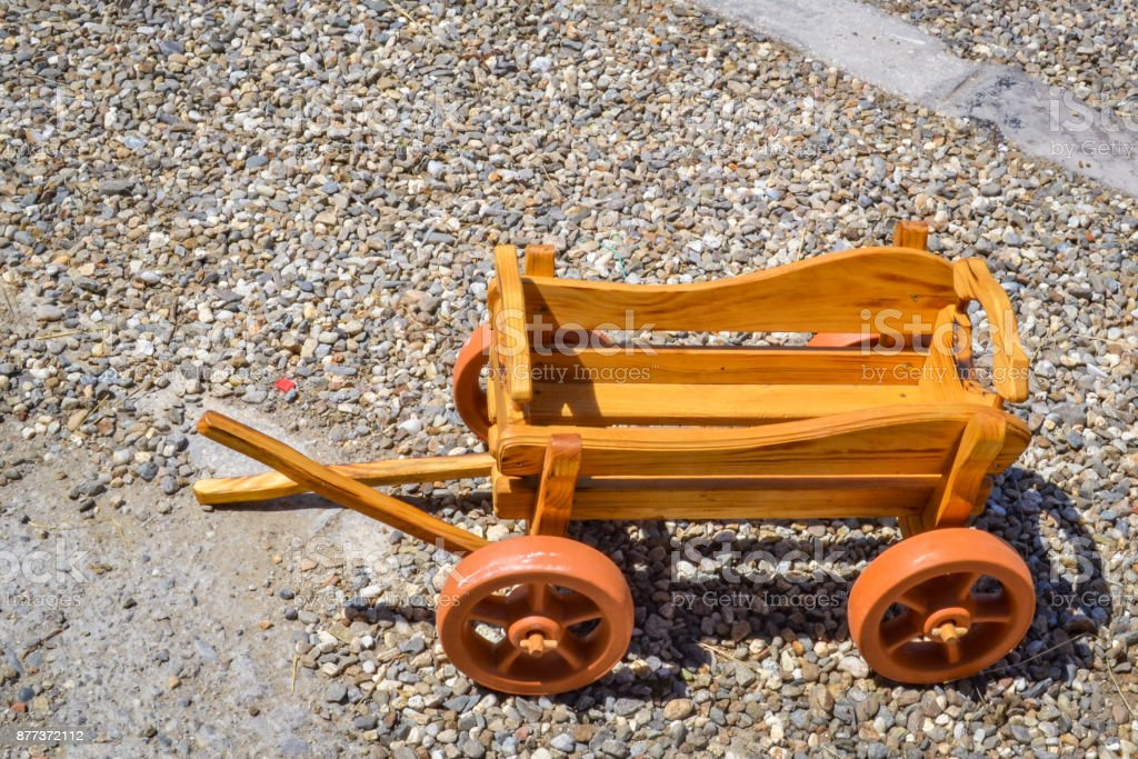 Rustic decorative dray made of wood in miniature stock photo