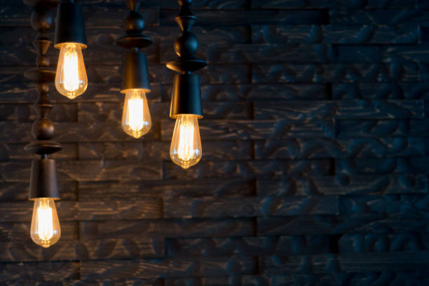 rustic design, brick wall with light bulbs and pipes - steampunk stock photos and pictures