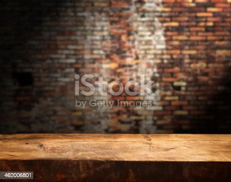 istock Rustic empty wooden table in front of brick wall 462006801