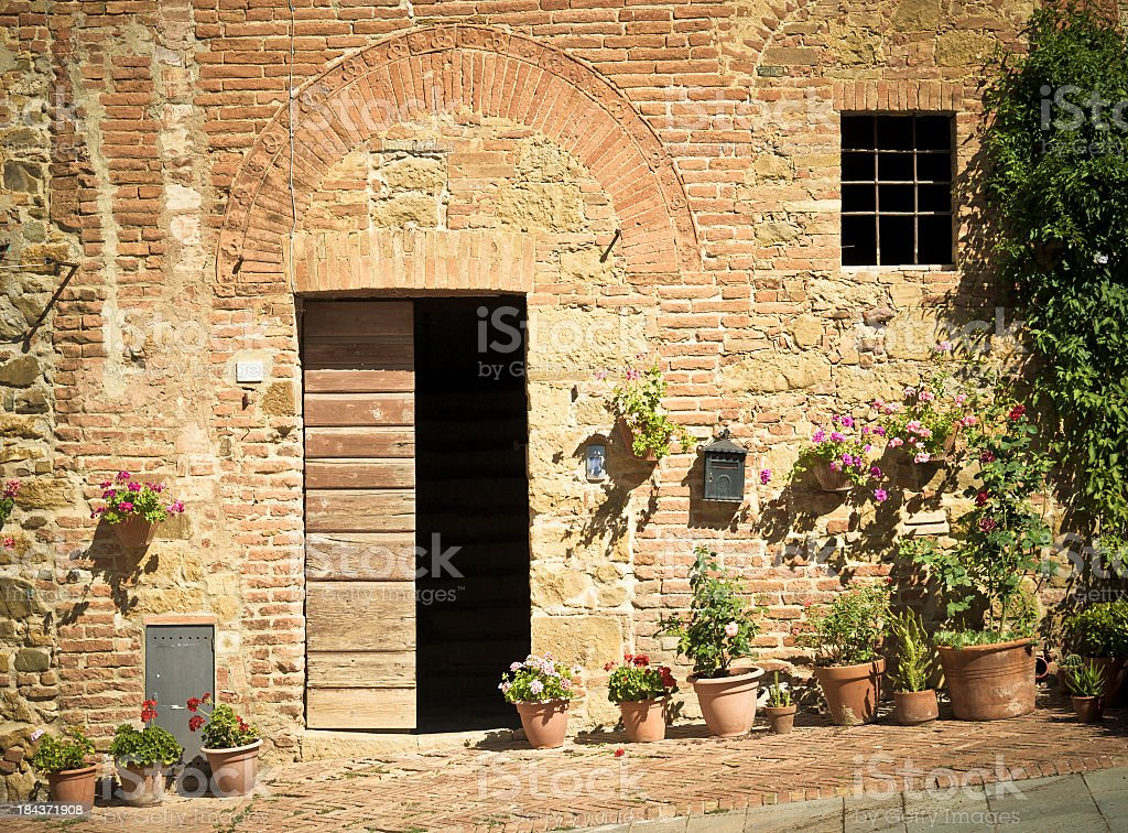 Rustic Facade House In Monticchiello Town, Val D'Orcia, Tuscany royalty-free stock photo