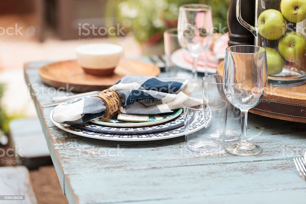 Rustic farm place setting with white and blue plates stock photo