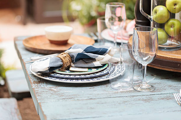 rustic farm place setting with white and blue plates - blue table setting stock photos and pictures