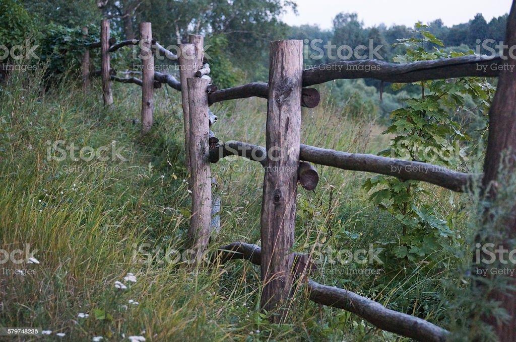 rustic fence at Polenovo near cemetery stock photo