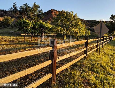 Rustic fence lit by sunset glow along Grafton Road in Rockville Utah