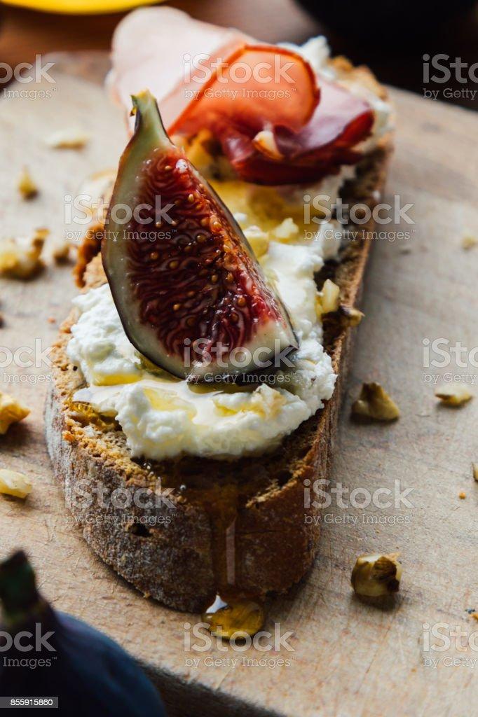 rustic figs bruschetta stock photo