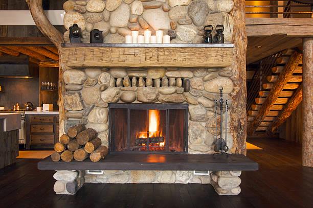 rustic fireplace - kütük ev stok fotoğraflar ve resimler