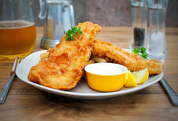 Rustic fish and chips stock photo