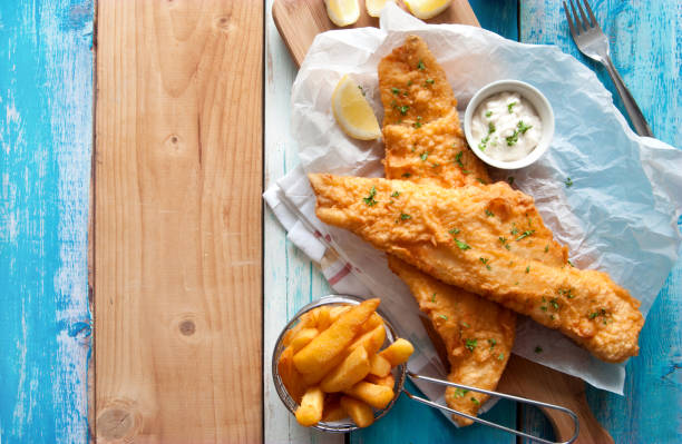 rustic fish and chips - fish stock pictures, royalty-free photos & images