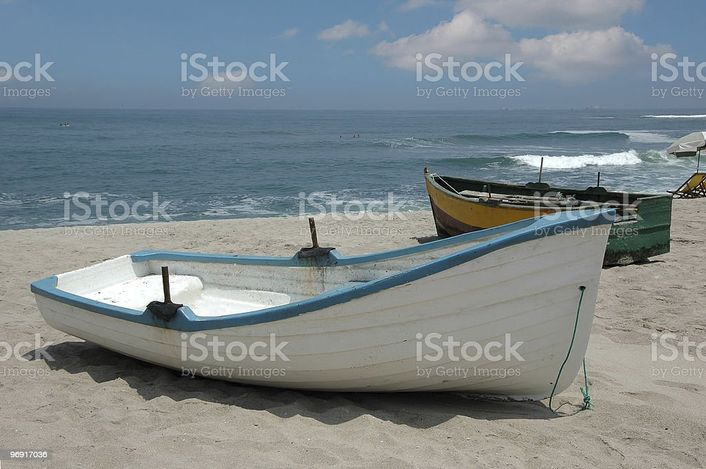 Rustic fishing boats in the coast of Lima Peru royalty-free stock photo