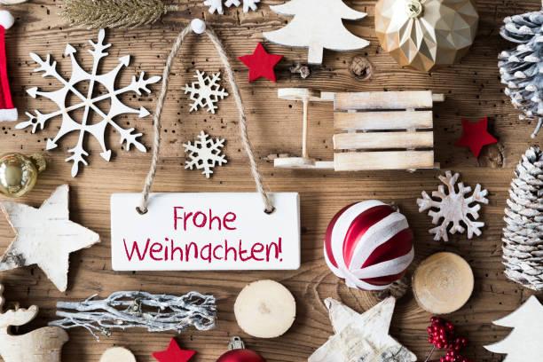 rustik düz lay, frohe weihnachten mutlu noeller anlamına gelir. - weihnachten stok fotoğraflar ve resimler