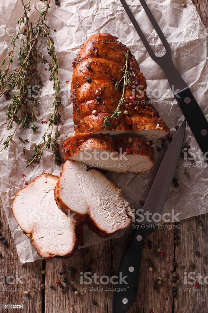 rustic food: roasted turkey breast close-up. vertical top view stock photo
