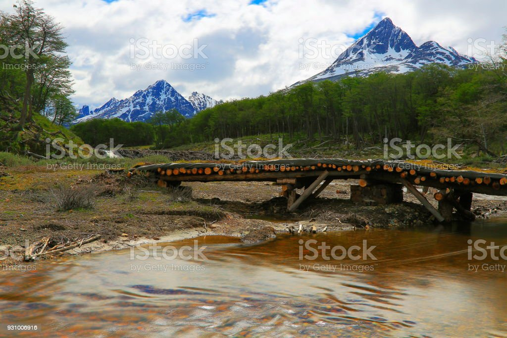 Rustic footbridge over river, Ushuaia idyllic landscape - Tierra Del fuego, Argentina stock photo
