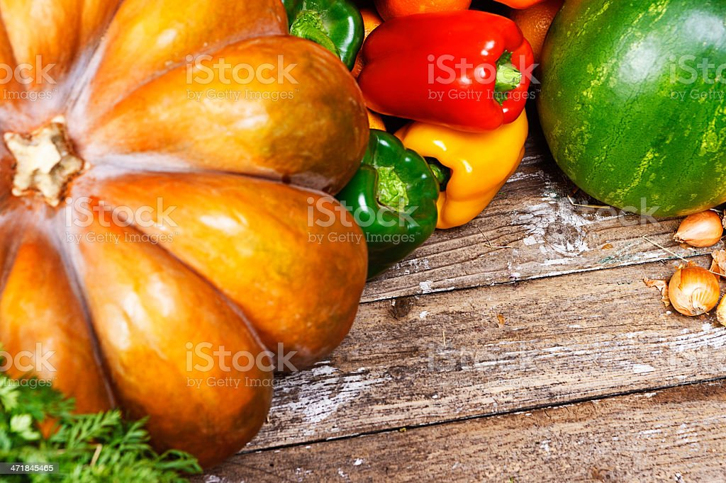 Rustic fruit and vegetables on weathered wooden background royalty-free stock photo
