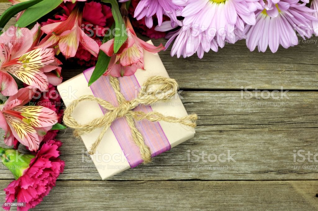 Rustic Gift Box With Flower Border On A Wood Background Royalty Free Stock Photo
