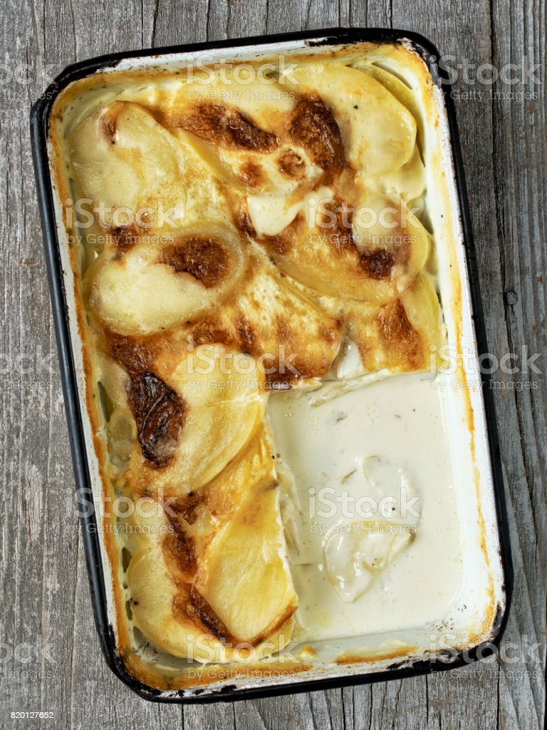 rustic golden scalloped potato gratin dauphinois stock photo