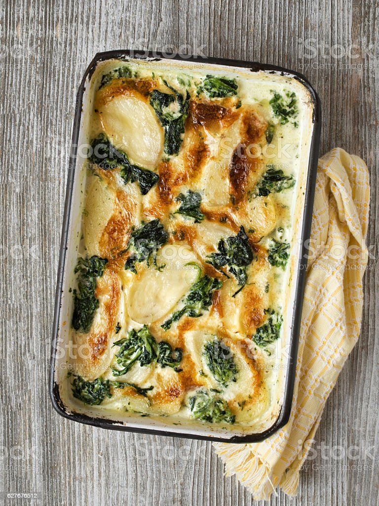 rustic golden spinach potato gratin dauphinois stock photo