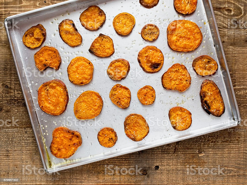 rustic golden sweet potato chips stock photo