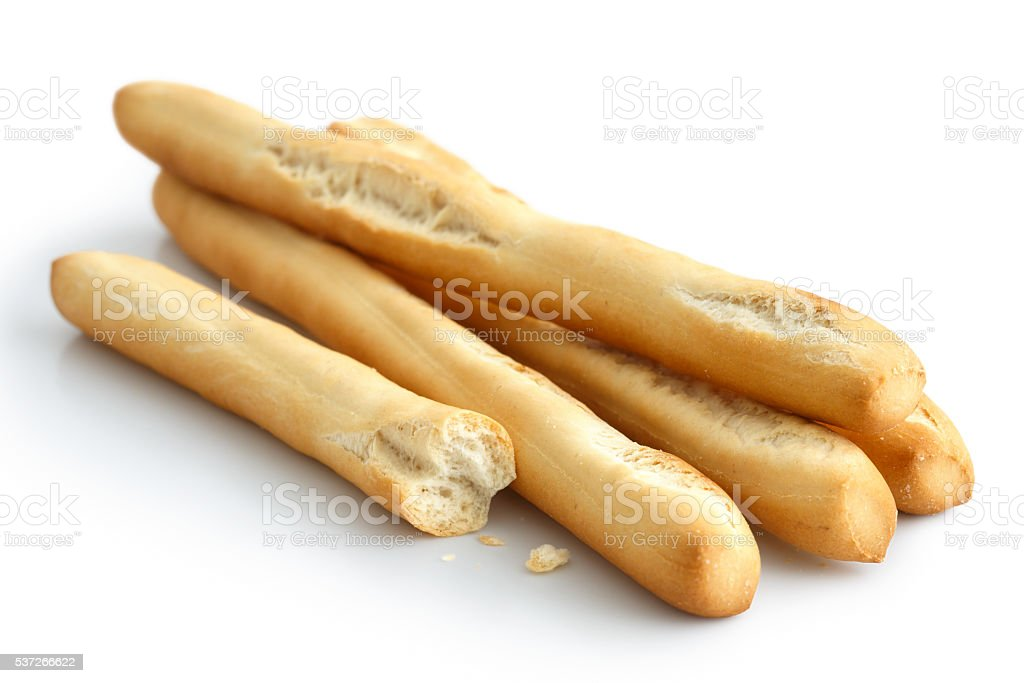 Rustic grissini bread sticks. Isolated on white. stock photo