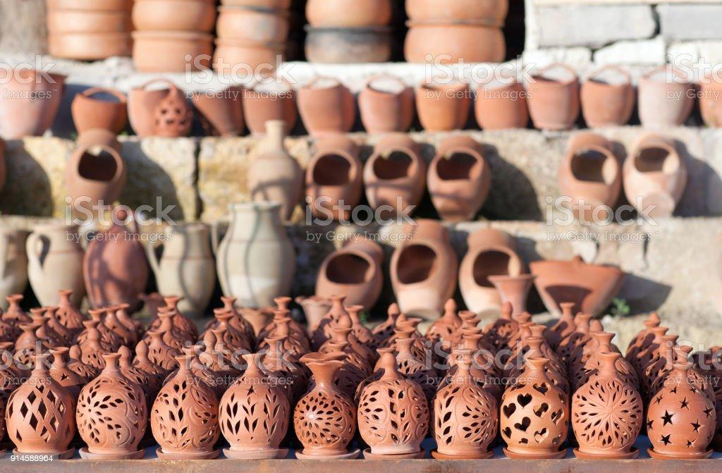 Rustic handmade ceramic clay pots at street handicraft market stock photo