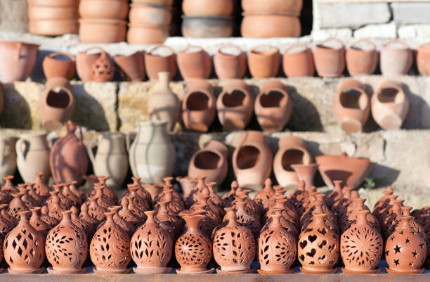 Rustic handmade ceramic clay pots at street handicraft market stock photo