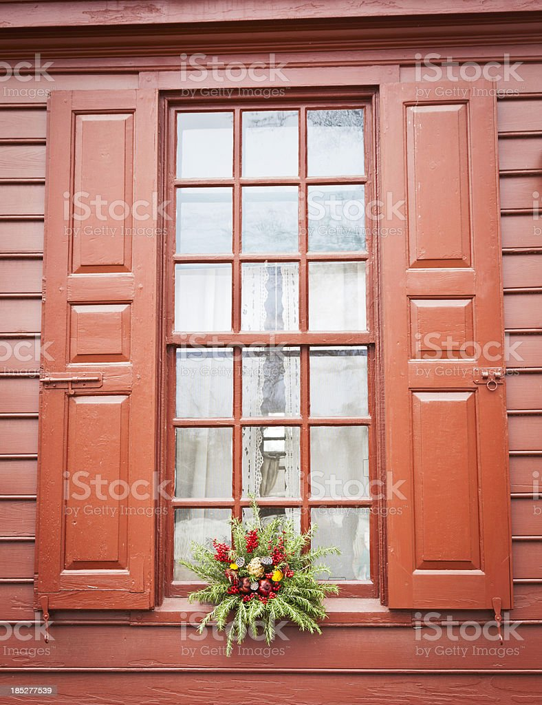 Rustic Holiday Decoration on Colonial-Style Window royalty-free stock photo
