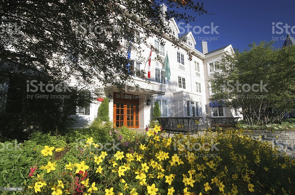 Rustic Hotel entrance with flower arrangement royalty-free stock photo