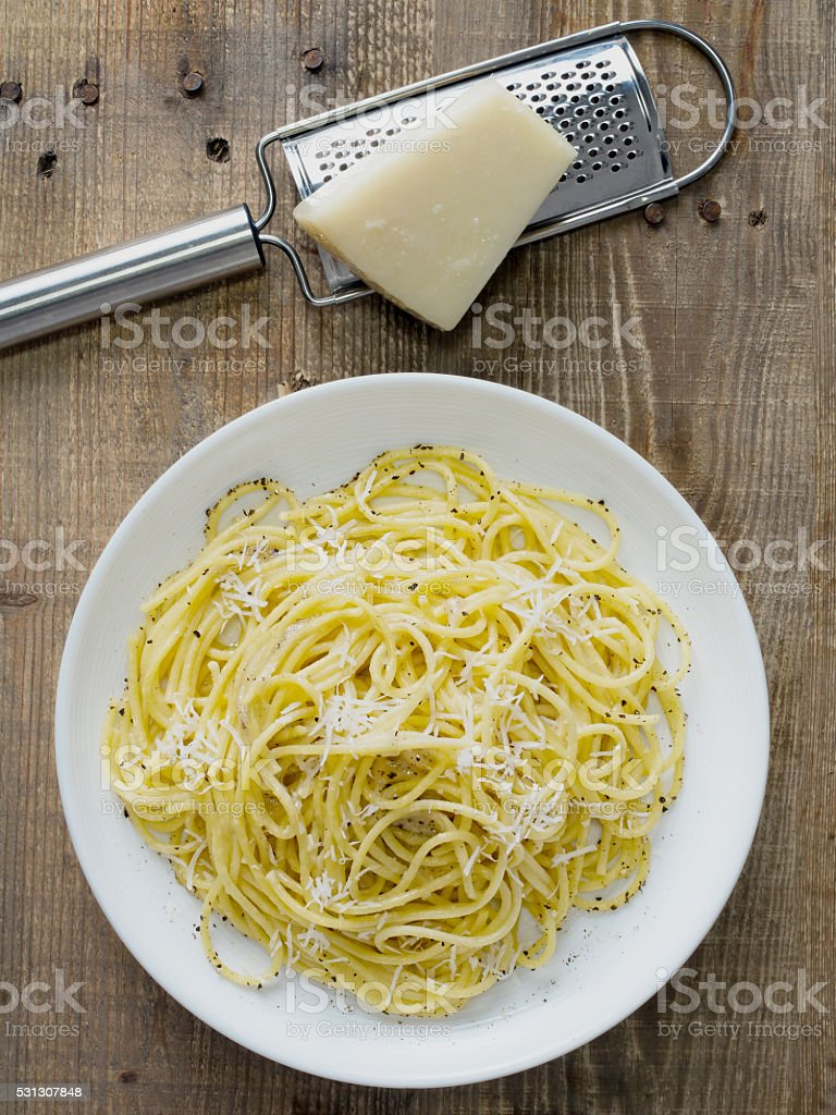 rustic italian pepe e cacio pepper with cheese spaghetti stock photo