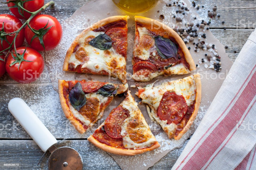 rustic italian pizza with mozzarella, cheese and basil leaves royalty-free 스톡 사진