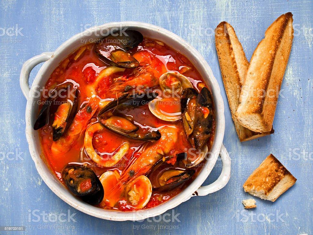 rustic italian seafood soup stock photo